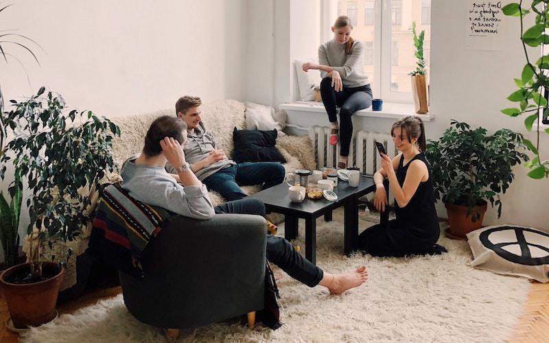 people gathering inside bachelors home